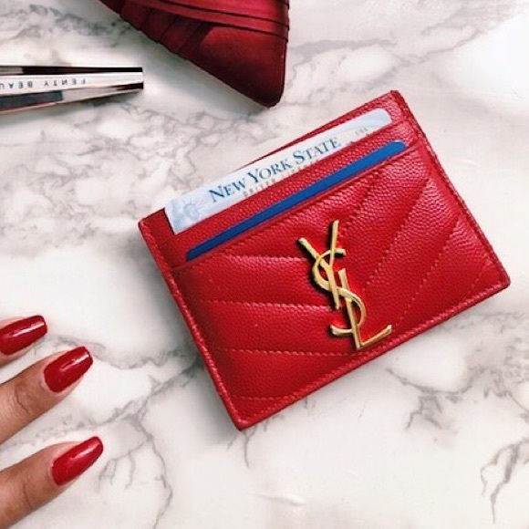 half off 567d6 f6bd3 Red leather YSL card holder with gold detail.